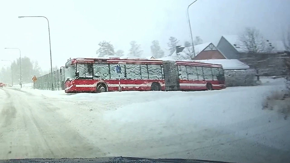Hundreds of years after the ice age, aliens start finding these snowed-in buses
